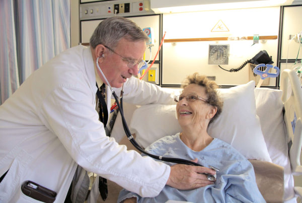 Cardiologist and patient interacting